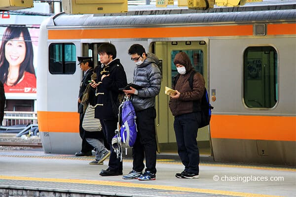 Some locals waiting for their train to Tokyo Station