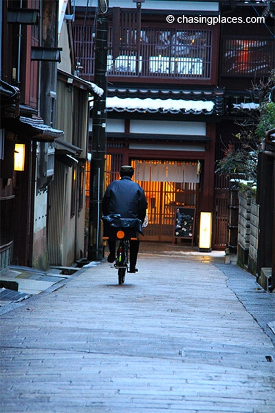 A local cyclist in Kanazawa's Geisha District