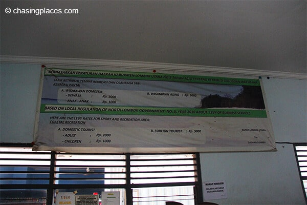 Additional charges to visit the Gili Islands posted in Bangsal's dreary ticket office