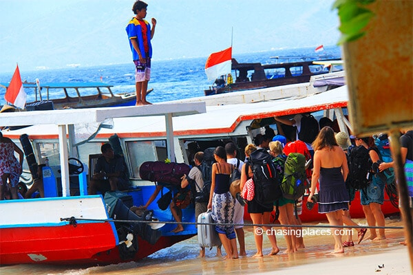 Tourist boarding the boat to Bangsal Harbor