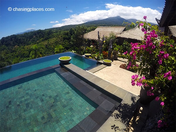 Rinjani Lodge's infinity pool greenery and Mount Rinjani in the background