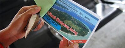 The environment fee ticket tourists must pay when visiting the Gili Islands.